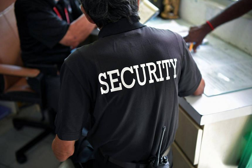 A security guard in his guard post at a condominium in Upper Bukit Timah, on Feb 14, 2019.