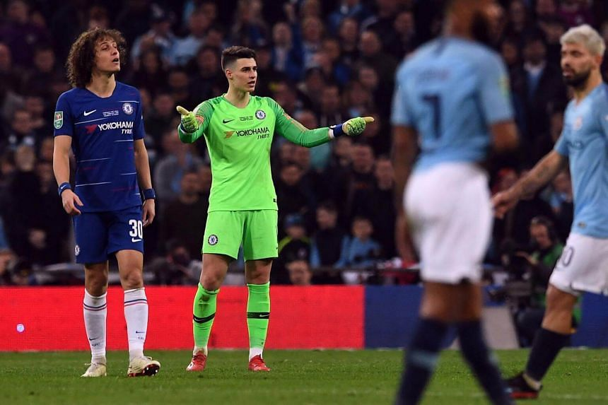 Chelsea's goalkeeper Kepa Arrizabalaga (in green) gestures during the match against Manchester City at Wembley stadium in London.