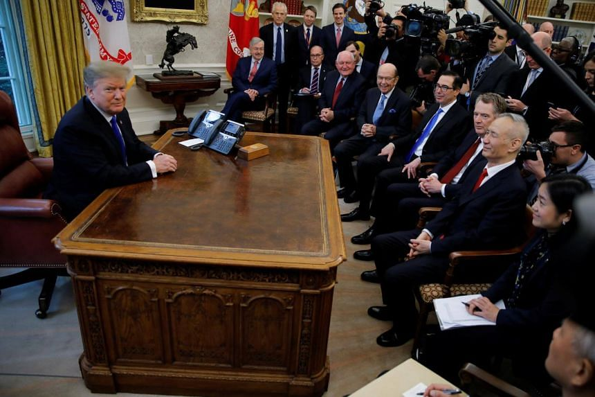 US President Donald Trump during a meeting with Chinese Vice-Premier Liu He (third, right) in the Oval Office at the White House in Washington, on Feb 22, 2019.
