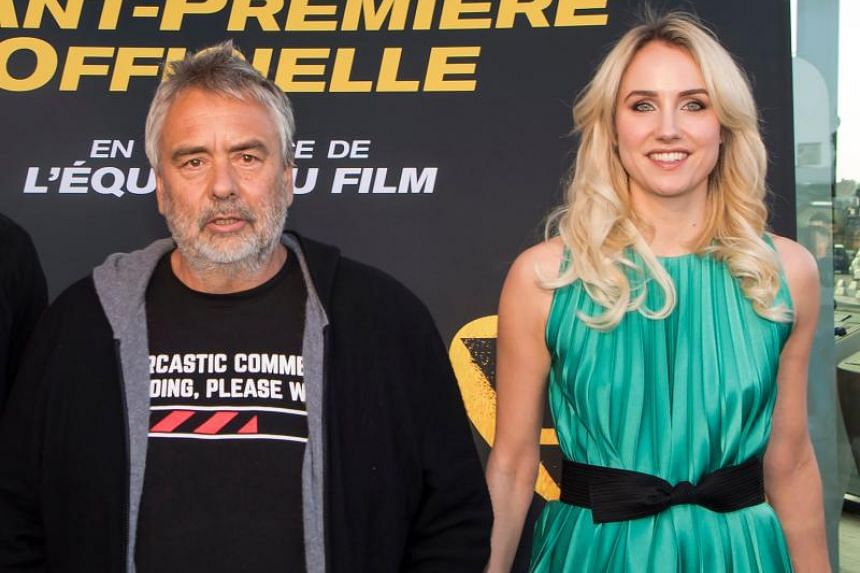 French producer Luc Besson and French actress Sand Van Roy at the photocall for the premiere of the film Taxi 5 at the Plan de Campagne commercial area in Les Pennes-Mirabeau, southern France, on April 06, 2018.