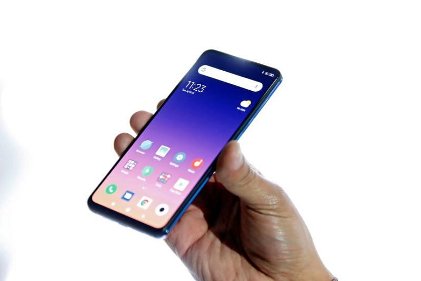 A visitor holds the new Xiaomi Mi MIX 3 5G during its presentation on the eve of the Mobile World Congress 2019, in Barcelona, Spain, on Feb 24, 2019.