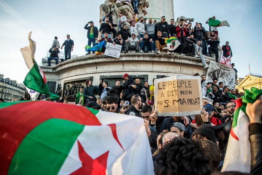 Protesters from the Franco-Algerian community gather at Republic square to protest against the fifth term of Algerian President, Abdelaziz Bouteflika in Paris, France, on Feb 24, 2019.