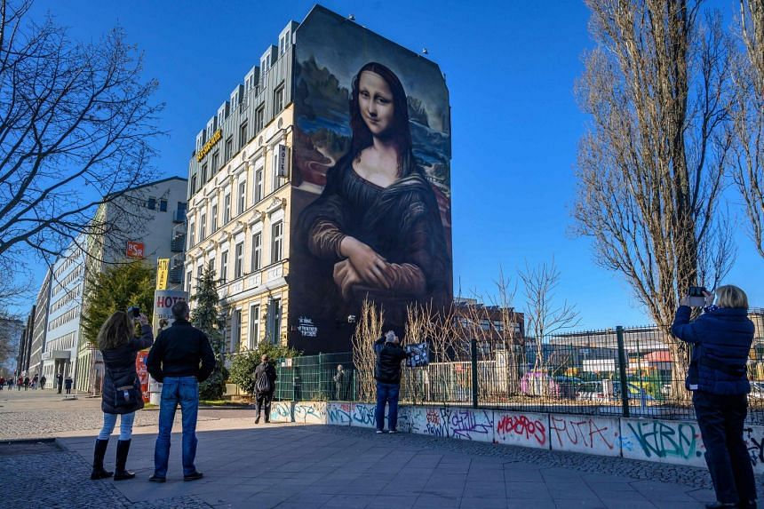 The portrait - more than 16m high and 11m wide - was painted on a hotel wall facing another iconic artwork: the East Side Gallery, a series of murals painted on remnants of the Berlin Wall that once divided the city before reunification.