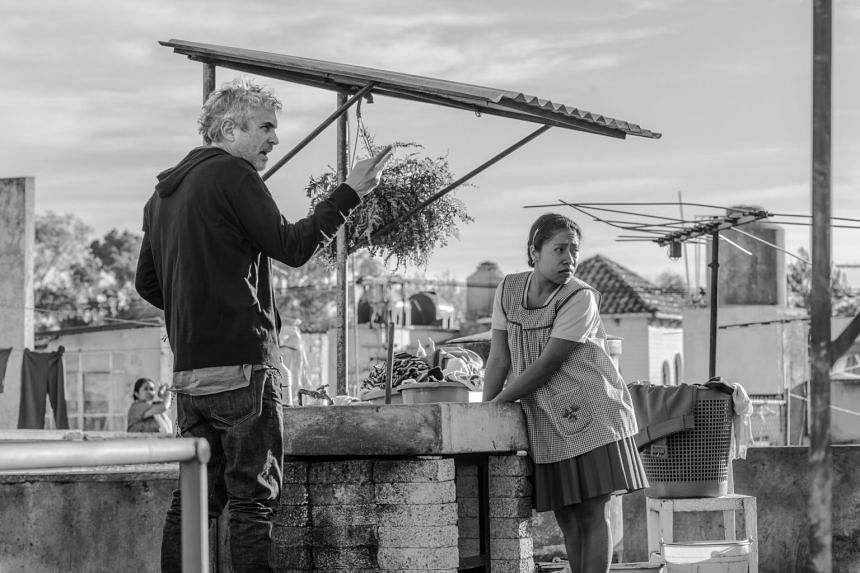 Writer-director Alfonso Cuaron (left) and Yalitza Aparicio on the set of Roma. The film marked Mexico's first Oscar victory in the category and has already picked up a slew of other awards this year.
