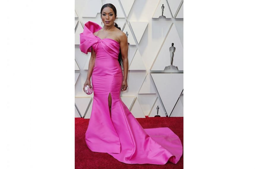 ANGELA BASSETT IN REEM ACRA: Pink was a popular choice on the red carpet, with many actresses such as Sarah Paulson, Helen Mirren and Gemma Chan sporting it. But no one did it better than Bassett, 60, who turned up in a bold, pink, one-shoulder Reem Acra