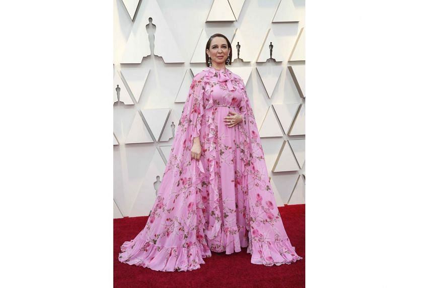 MAYA RUDOLPH IN GIAMBATTISTA VALLI: Comedienne and former Saturday Night Live cast member Rudolph, 46, did not seem to get the memo that you cannot attend the Oscars draped in bedsheets from your grandmother's retirement home. Not even if you fashion it i