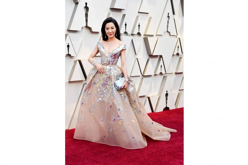 MICHELLE YEOH IN ELIE SAAB: That insanely beautiful diamond bracelet would have landed Yeoh on the best-dressed list. But the rest of her look was on point as well. The 56-year-old Malaysian actress may not have been nominated for her ice-cold portrayal o