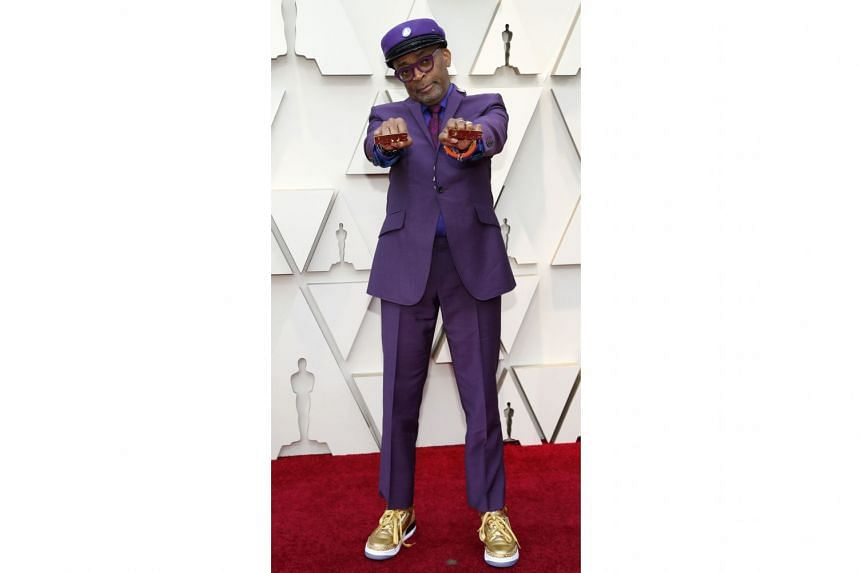 SPIKE LEE IN OZWALD BOATENG: Lady Gaga was not the only one paying tribute to legends on the Oscars red carpet. Director Lee, 61, who took home Best Adapted Screenplay for BlacKkKlansman, wore a purple number inspired by his friend Prince, who died in 201