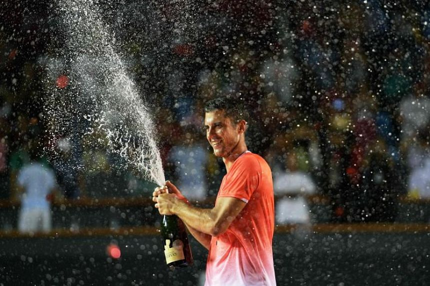 Serbia's Laslo Djere celebrates after beating Canada's Felix Auger-Aliassime in the ATP World Tour Rio Open singles final match at the Jockey Club in Rio de Janeiro, Brazil on Feb 24, 2019.