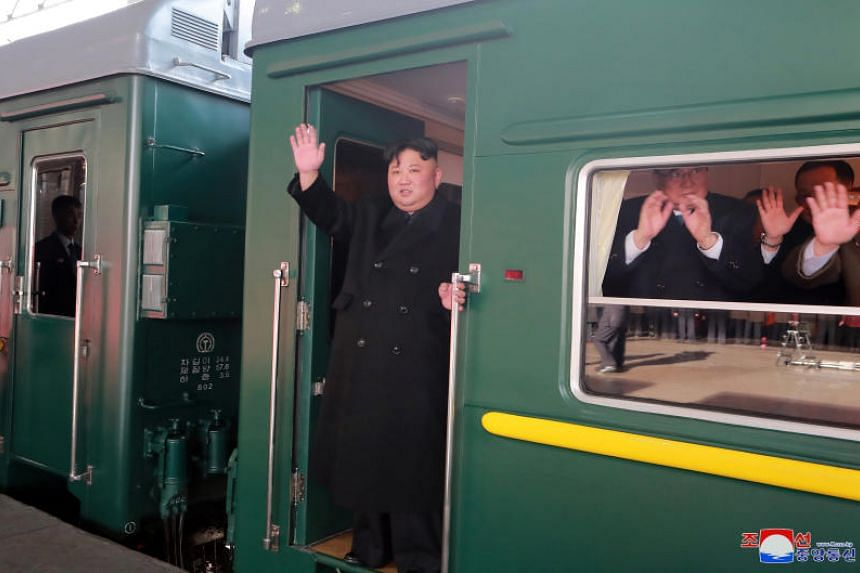 North Korean leader Kim Jong Un waving from his armoured train as he left Pyongyang on Feb 23  for a summit in Hanoi with US President Donald Trump.