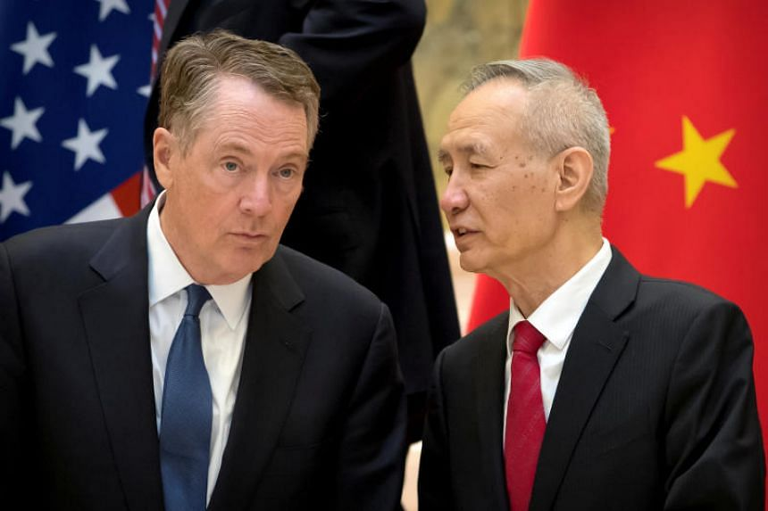 US Trade Representative Robert Lighthizer (left) listens as Chinese Vice Premier Liu He talks while they line up for a group photo at the Diaoyutai State Guesthouse in Beijing on Feb 15, 2019.