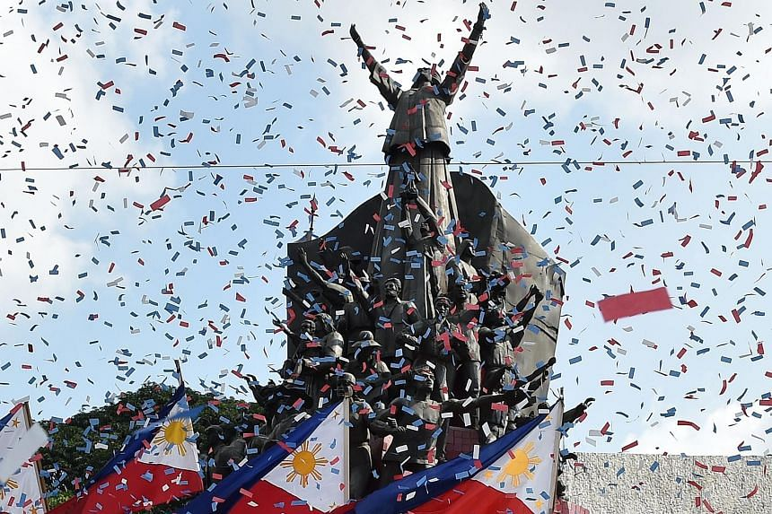 Confetti being showered on the People Power monument to commemorate the 33rd anniversary of the revolt yesterday.