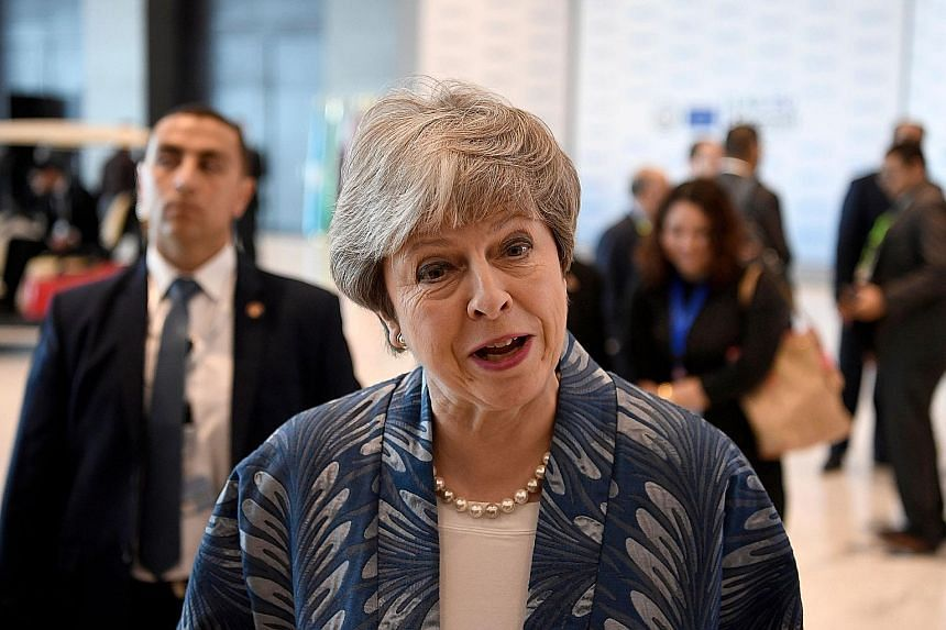 Mrs Theresa May speaking to the press during the European Union and Arab League summit at Sharm el-Sheikh on Sunday.