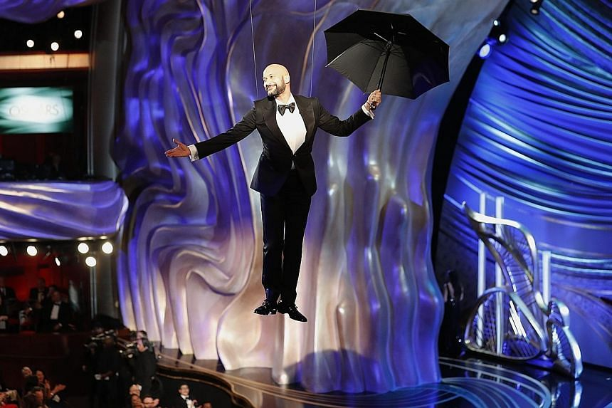 """Keegan-Michael Key """"floated"""" in with an umbrella to introduce Bette Midler performing a song from Mary Poppins Returns."""