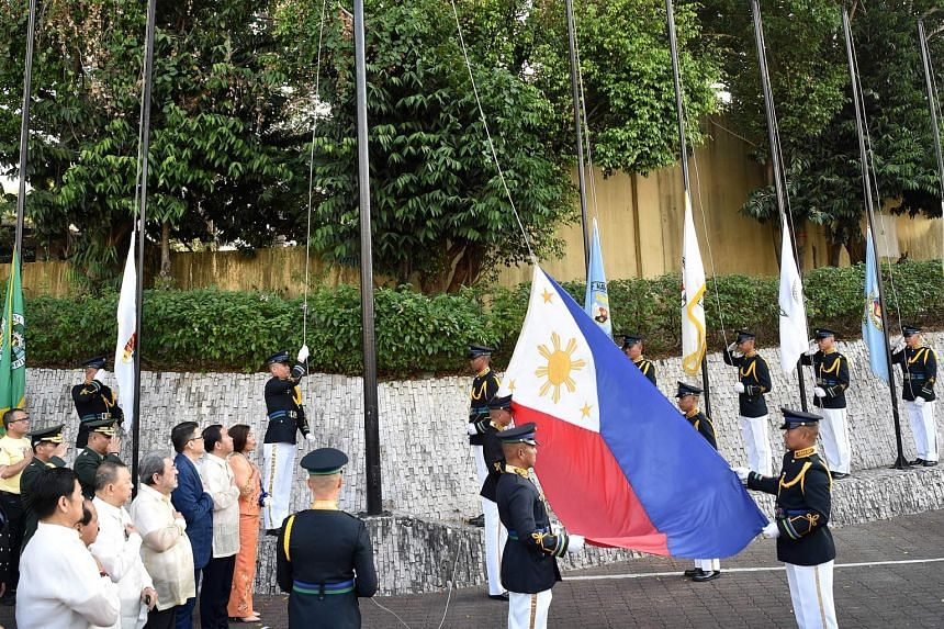 Philippine military personnel at a flag-raising ceremony to commemorate the 33rd anniversary of the People Power movement in Manila yesterday. The 1986 revolt toppled dictator Ferdinand Marcos from power, sending his family into exile in Hawaii.
