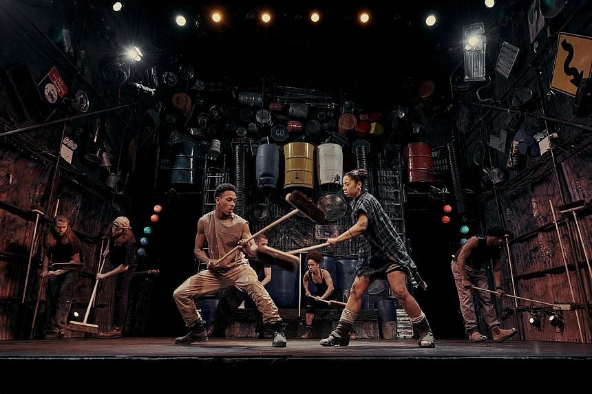 Actors in Stomp at the Orpheum Theatre in New York use everyday objects such as brooms to create a wordless percussive explosion onstage.
