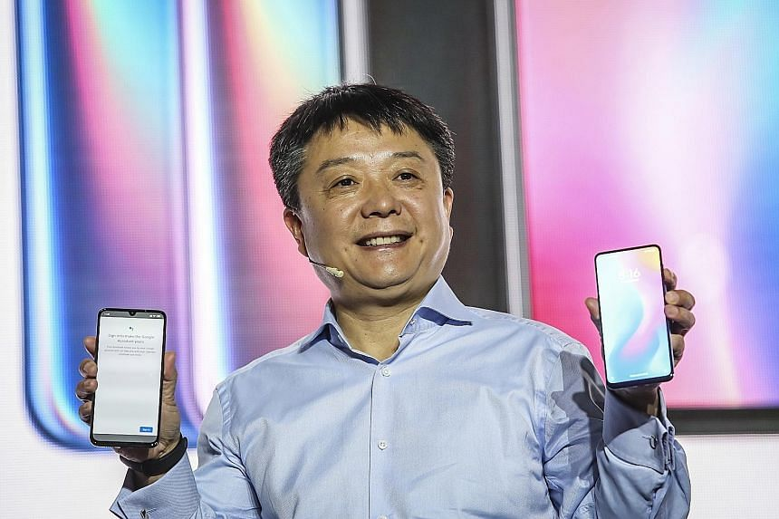 Xiaomi senior vice-president Wang Xiang with the Mi 9 and Mi Mix 3 5G phones at a launch event ahead of Mobile World Congress on Sunday. Huawei consumer business group chief Richard Yu presenting the 5G-capable Mate X at the Mobile World Congress in