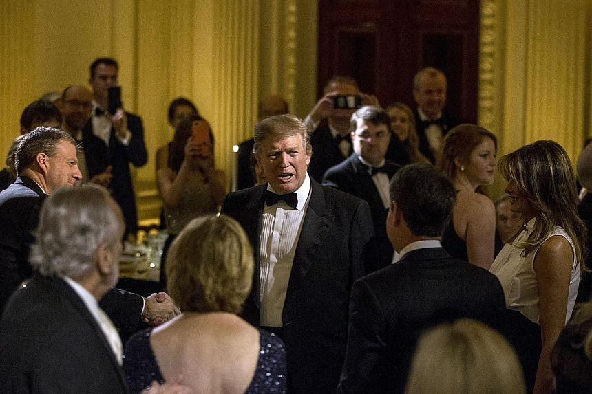 United States President Donald Trump (centre) and First Lady Melania Trump (far right) at the Governors' Ball in the White House on Sunday. Mr Trump had announced that the tariff hike on US$200 billion (S$270 billion) worth of Chinese goods, schedule