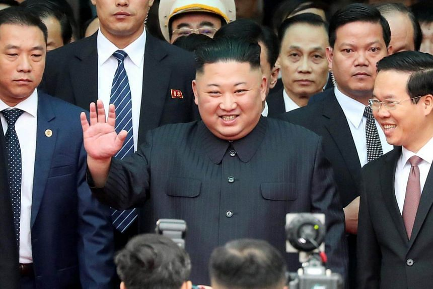 North Korean leader Kim Jong Un waves after arriving at the Dong Dang railway station in Vietnam.