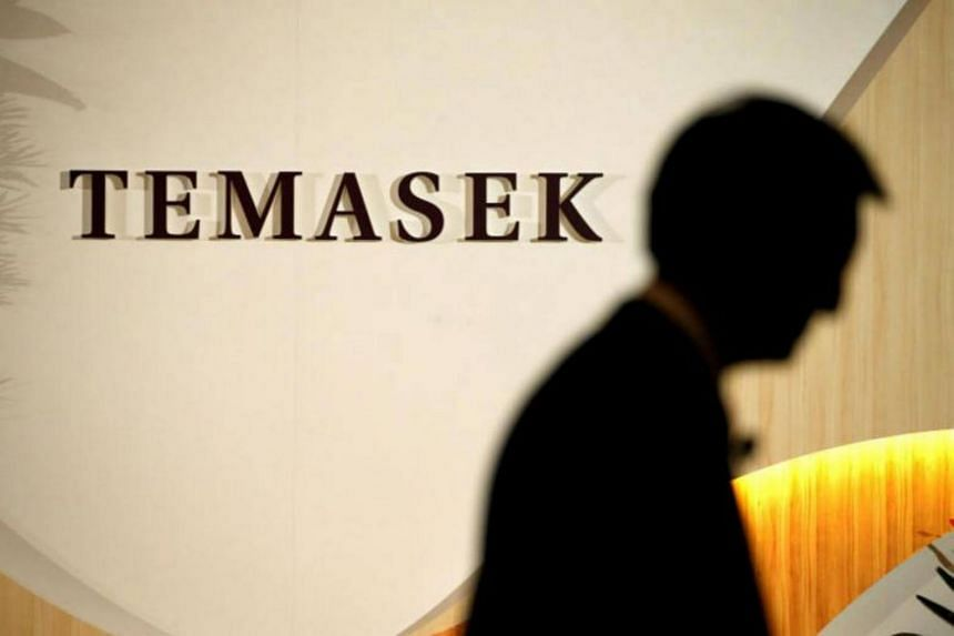 The logo of Singapore government investment firm Temasek Holdings seen outside one of its offices.