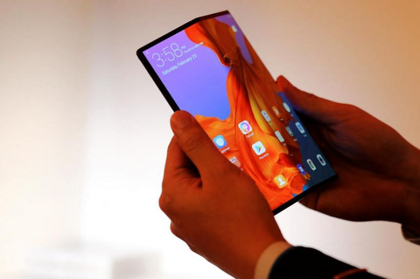 A member of Huawei staff shows the new Huawei Mate X device during a pre-briefing display ahead of the Mobile World Congress in Barcelona, Spain, on Feb 23, 2019.