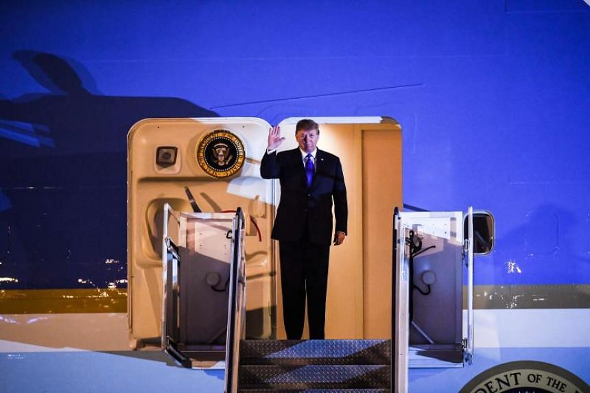 US President Donald Trump disembarks from Air Force One at Noi Bai International Airport in Hanoi on Feb 26, 2019.