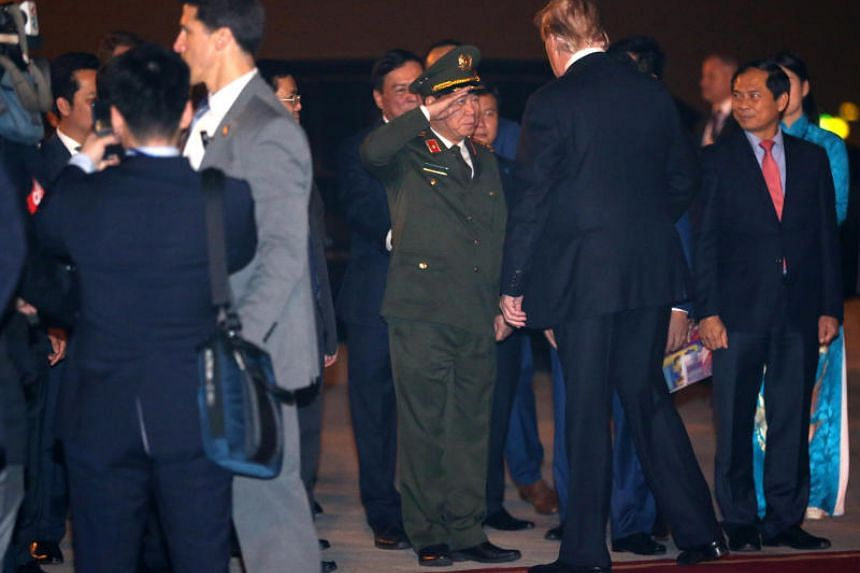US President Donald Trump is welcomed by Vietnamese officials as he arrives at Noi Bai International Airport in Hanoi on Feb 26, 2019.