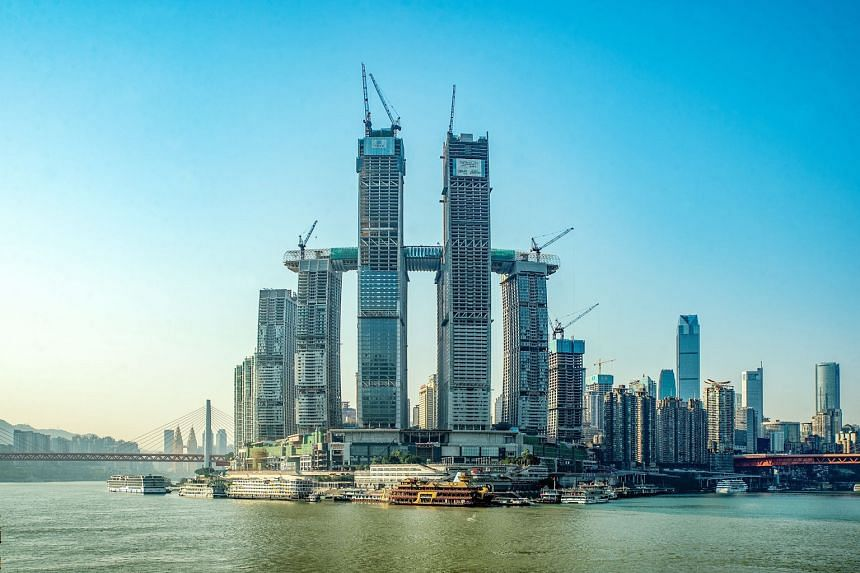 The 1.12 million sq m megastructure Raffles City Chongqing (left) is on track to open in the second half of this year in the Chinese city. The eighth and final skyscraper of the development was topped out on Jan 25, marking a milestone for Singapore-