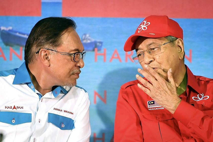 Datuk Seri Anwar Ibrahim (left in photo) told Bloomberg in a Feb 13 interview that Prime Minister Mahathir Mohamad will leave the post within two years. But Tun Dr Mahathir told the Indonesia media last week that he needs at least 21/2 years to fix M