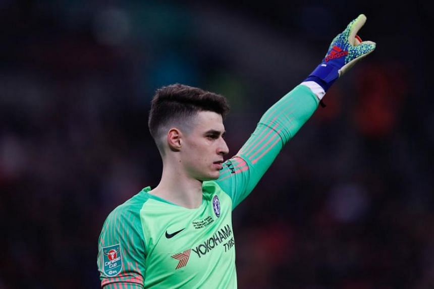 Chelsea's Kepa Arrizabalaga gestures during the English League Cup final football match between Manchester City and Chelsea at Wembley stadium in London on Feb 24, 2019.