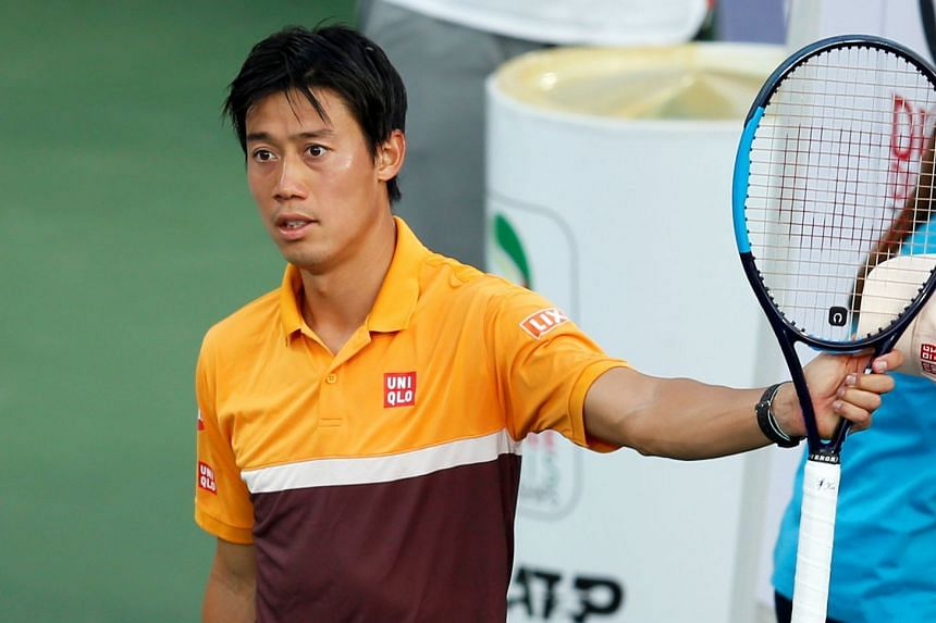 Nishikori reacts after defeating Benoit Paire of France in their first-round match.