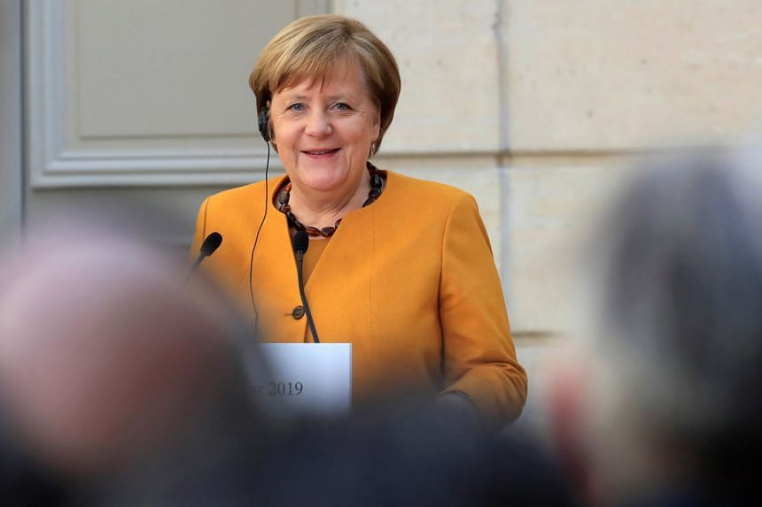 Merkel gives a joint press conference with the French President  in Paris, Feb 27, 2019.