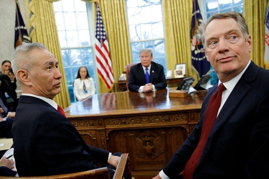 US President Donald Trump looks on during a meeting with China's Vice-Premier Liu He and Robert Lighthizer (right) in the Oval Office.