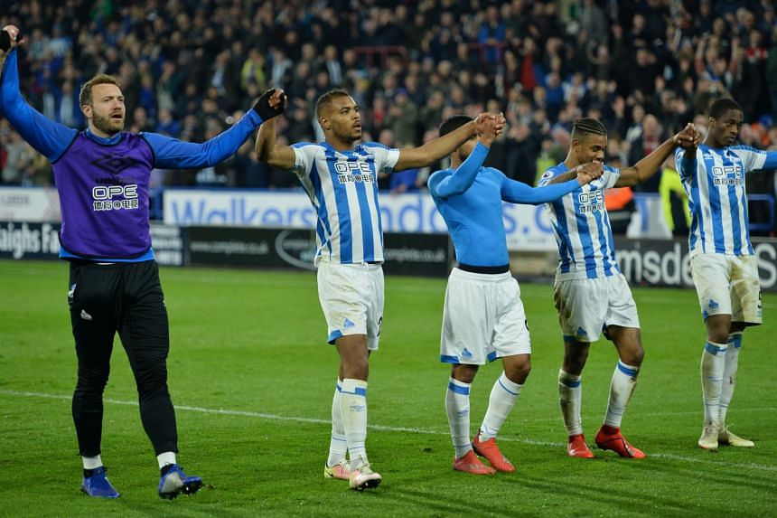 Huddersfield Town's Steve Mounie celebrates with team mates after the match.