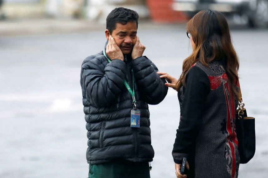 A Yeti Airlines staff member reacts after the crash. Yeti managing director Ang Tshiring Sherpa is said to have been aboard.