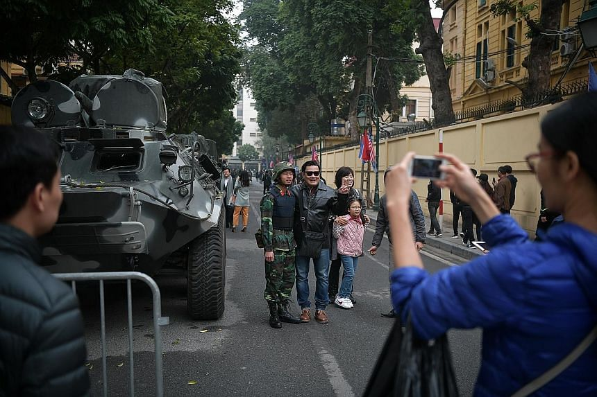 Tanks and soldiers stationed near the Sofitel Legend Metropole Hanoi hotel in the Vietnamese capital drew the attention of both locals and tourists, who stopped to pose for pictures. Although the meeting venue has not been officially announced, secur
