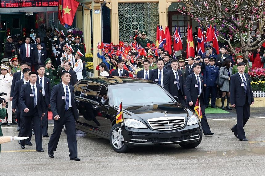 North Korean leader Kim Jong Un leaving Dong Dang station in a car for Hanoi yesterday, surrounded by his bodyguards. He arrived in Vietnam after a three-day train journey from Pyongyang. United States President Donald Trump disembarking from Air For