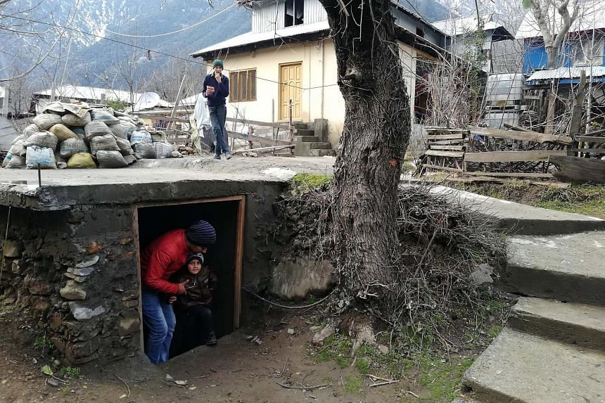 People seen preparing a bunker for emergency situations in Kashmir on Sunday amid growing tensions between India and Pakistan.