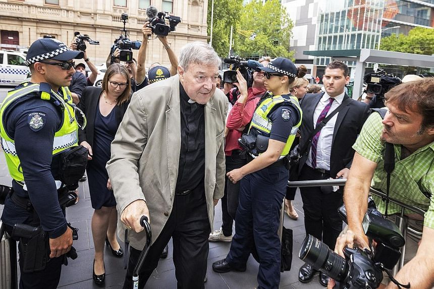 Cardinal George Pell (centre) arriving at the Victorian County Court in Melbourne yesterday. One of Pope Francis' closest advisers, Pell, 77, has been found guilty of sexually assaulting two choirboys, becoming the most senior Catholic cleric ever co
