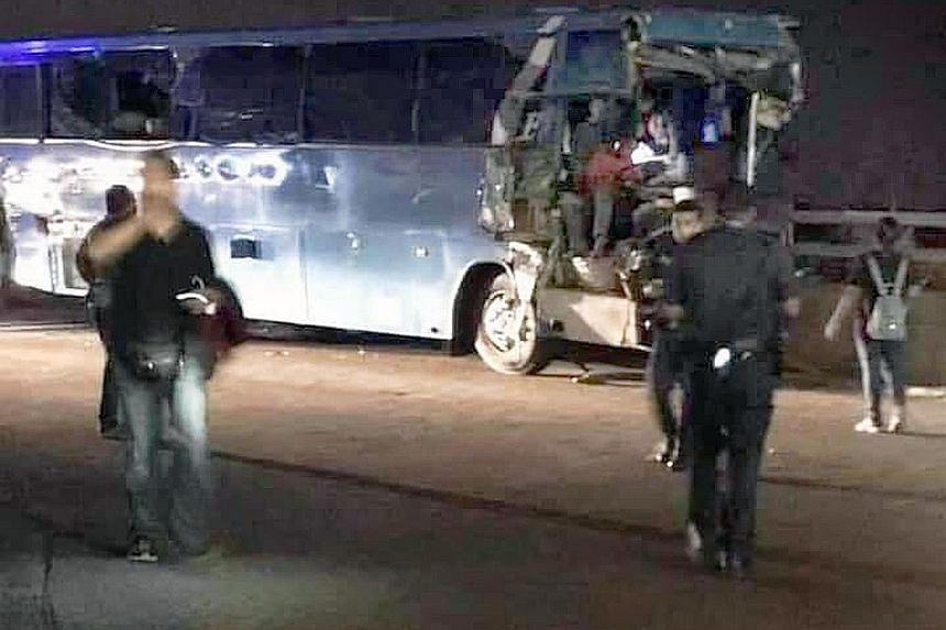 A picture (left) circulating widely on social media showing the damaged bus after the accident that caused a major traffic jam at the Second Link (above).