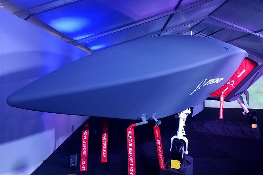 A model of Boeing's new unmanned, fighter-like jet, called the Boeing Airpower Teaming System, is displayed in Avalon, Australia, on Feb 27, 2019.