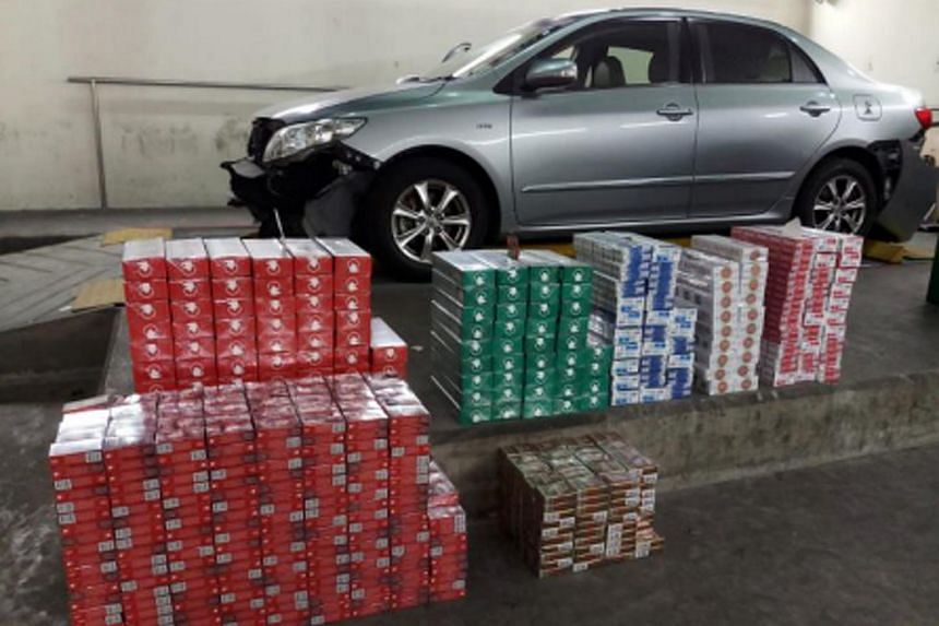 ICA officers discovered 180 cartons and 1,041 packets of duty-unpaid cigarettes in a car at Tuas Checkpoint on Sept 8, 2018.