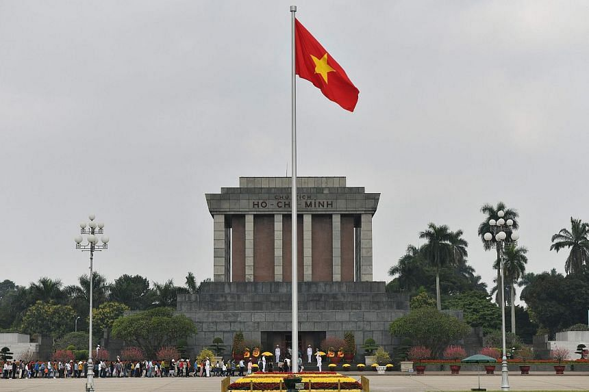 A Vietnamese national flag flutters in the wind at the Ho Chih Minh mausoleum in Hanoi, Vietnam on Feb 9, 2019.