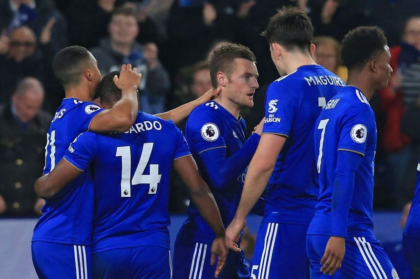 Leicester City's Jamie Vardy (centre) celebrates with teammates after scoring their second goal.