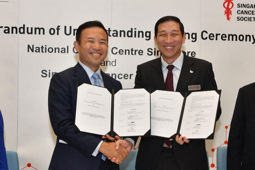 National Cancer Centre Singapore medical director William Hwang (left) and Singapore Cancer Society chief executive Albert Ching at the signing of a memorandum of understanding on Feb 27, 2019.
