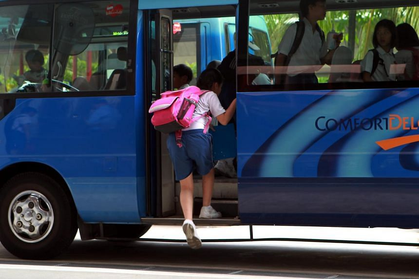 Pupils boarding a school bus at a school in Singapore.