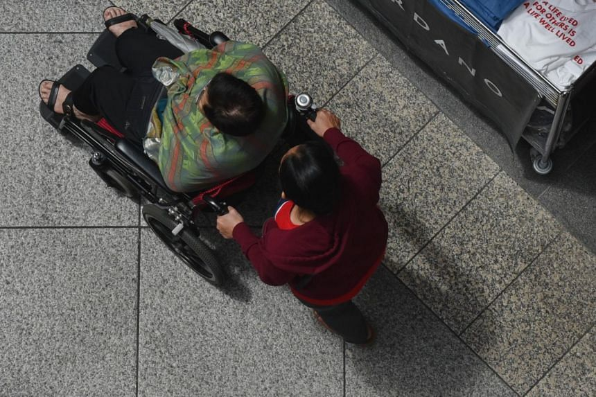 A caregiver pushing an elderly woman on a wheelchair, on Jan 23, 2019.