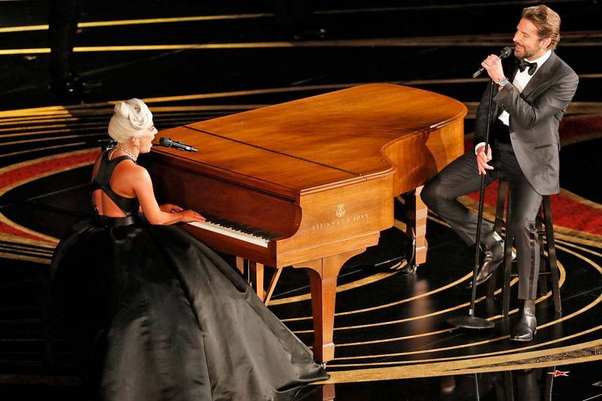 The stars of A Star Is Born, Lady Gaga and Bradley Cooper, performing the song, Shallow, at the Oscars.