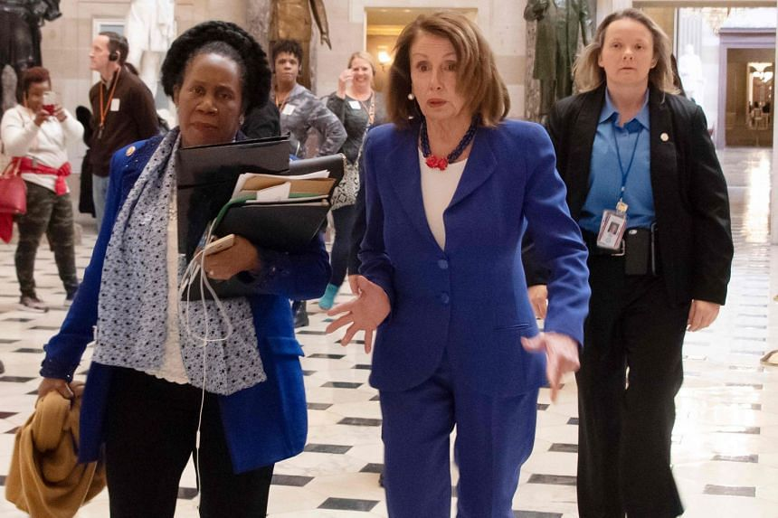 US House Speaker Nancy Pelosi (centre right) and congresswoman Sheila Jackson Lee (centre left) on their way to vote.