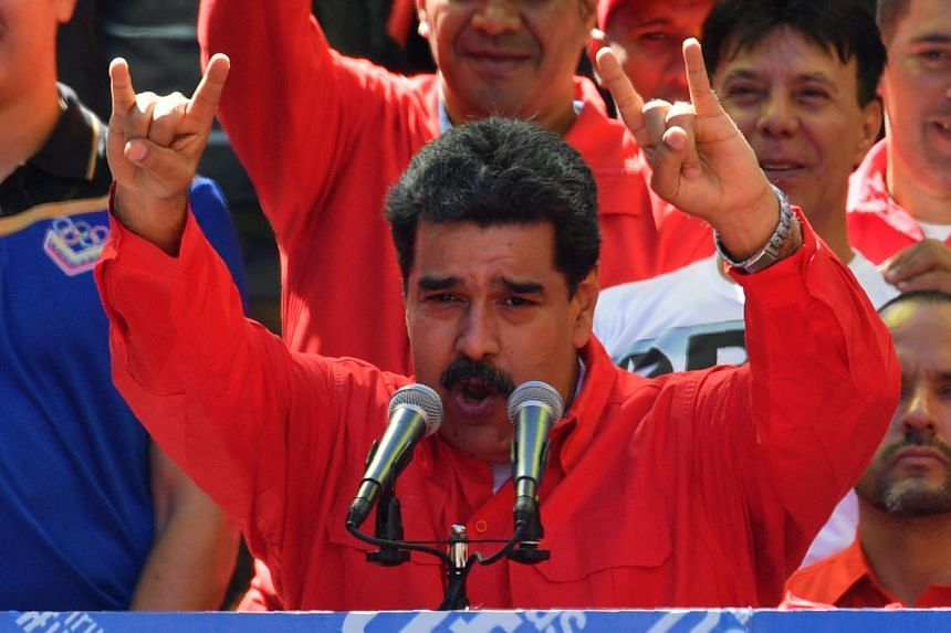 Maduro speaks during a pro-government march in Caracas, Feb 23, 2019.